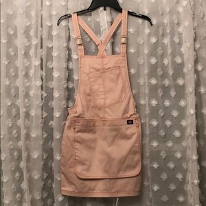 Pink overall dress by Urban outfitters size XS